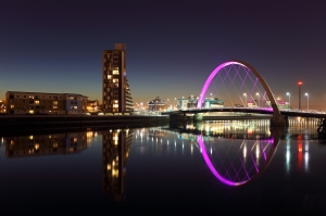 Bridge reflection across the River Clyde at night