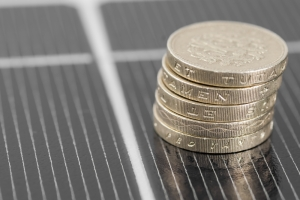 Money resting on a photovoltaic panel