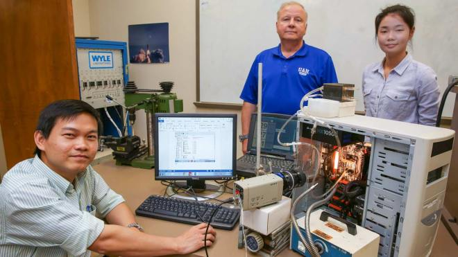 Graduate students Cuong Nguyen and Xiaolin Wang work with Dr James E. Smith Jr. on a technology that keeps computer chips cooler